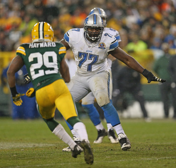 GREEN BAY, WI - DECEMBER 09:  Gosder Cherilus #77 of the Detroit moves to block Casey Hayward #29 of the Green Bay Packers at Lambeau Field on December 9, 2012 in Green Bay, Wisconsin. The Packers defeated the Lions 27-20.  (Photo by Jonathan Daniel/Getty