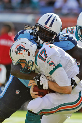 Nov.11, 2012;  Miami, FL, USA; Tennessee Titans defensive tackle Sen'Derrick Marks (94) brings down Miami Dolphins quarterback Ryan Tannehill (17) during the second half at Sun Life Stadium. Tennessee won 37-3. Mandatory Credit: Steve Mitchell-USA TODAY S