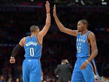 Jan 11, 2013; Los Angeles, CA, USA; Oklahoma City Thunder guard Russell Westbrook (0) and forward Kevin Durant (35) exchange high fives against the Los Angeles Lakers at the Staples Center. Mandatory Credit: Kirby Lee/USA TODAY Sports