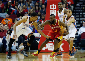 HOUSTON, TX - FEBRUARY 20:  James Harden #13 of the Houston Rockets drives against Thabo Sefolosha #2 of the Oklahoma City Thunder at Toyota Center on February 20, 2013 in Houston, Texas. NOTE TO USER: User expressly acknowledges and agrees that, by downl