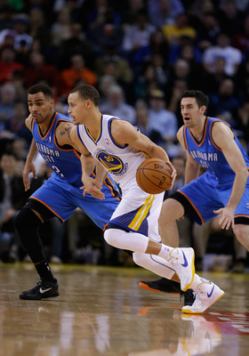 OAKLAND, CA - JANUARY 23: Stephen Curry #30 of the Golden State Warriors dribbles the ball against the Oklahoma City Thunder at Oracle Arena on January 23, 2013 in Oakland, California. NOTE TO USER: User expressly acknowledges and agrees that, by download