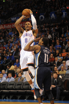 Jan 31, 2013; Oklahoma City, OK, USA; Oklahoma City Thunder guard Russell Westbrook (0) attempts a shot against Memphis Grizzlies guard Mike Conley (11) during the second half at the Chesapeake Energy Arena.  Mandatory Credit: Mark D. Smith-USA TODAY Spor
