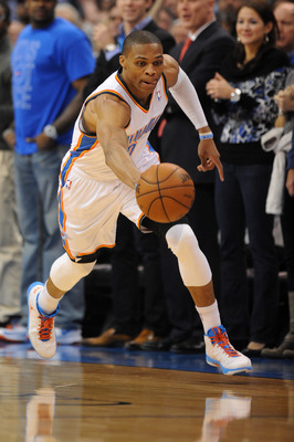 Dec 17, 2012; Oklahoma City, OK, USA; Oklahoma City Thunder guard Russell Westbrook (0) handles the ball against the San Antonio Spurs during the second half at Chesapeake Energy Arena.  Mandatory Credit: Mark D. Smith-USA TODAY Sports