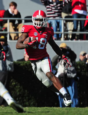 ATHENS, GA - NOVEMBER 24: Bacarri Rambo #18 of the Georgia Bulldogs runs with an interception against the Georgia Tech Yellow Jackets at Sanford Stadium on November 24, 2012 in Athens, Georgia. (Photo by Scott Cunningham/Getty Images)