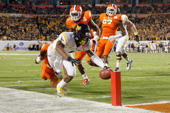 MIAMI GARDENS, FL - JANUARY 04:  Tavon Austin #1 of the West Virginia Mountaineers scores an 8-yard rushing touchdown in the first quarter against the Clemson Tigers during the Discover Orange Bowl at Sun Life Stadium on January 4, 2012 in Miami Gardens,