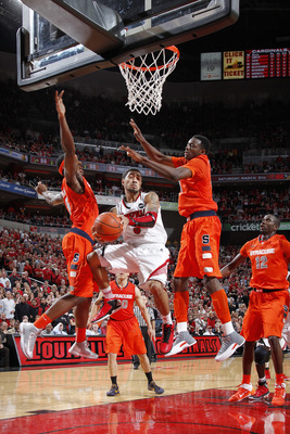 Louisville getting double teamed down low in the Big East tournament by the 2-3 Orange defense.