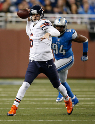 Jay Cutler evades pressure from the Detroit Lions' Lawrence Jackson.