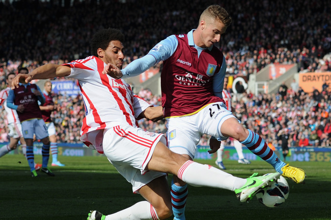 STOKE ON TRENT, ENGLAND - APRIL 06:  Ryan Shotton of Stoke City competes with Joe Bennett of Aston Villa during the Barclays Premier League match between Stoke City and Aston Villa at the Britannia Stadium on April 6, 2013 in Stoke on Trent, England.  (Ph