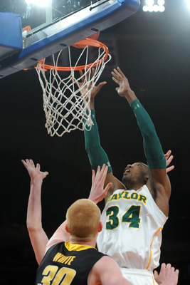 Apr 4, 2013; New York, NY, USA; Baylor Bears forward Cory Jefferson (34) puts up a shot over Iowa Hawkeyes forward Aaron White (30) during the first half of the championship game of the 2013 NIT basketball tournament at Madison Square Garden. Mandatory Cr