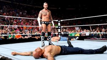 Punk stands tall as his opponents are lay flat on the mat. Image by WWE