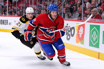 Brandon Prust of the Montreal Canadiens and Andrew Ference of the Boston Bruins.