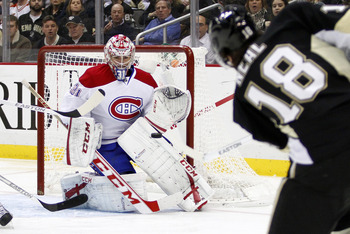 Montreal Canadien Carey Price stops a shot from Pittsburgh Penguin James Neal.