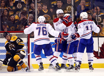 Montreal Canadien Max Pacioretty (center) celebrates with P.K. Subban, David Desharnais and Brendan Gallagher.