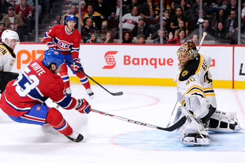 Montreal Canadien Ryan White misses the net in close on Boston Bruin goalie Tuukka Rask.