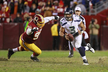 Redskins defensive tackle Barry Cofield bears down on Seahawks QB Russell Wilson in the January 2013 NFC Wild Card Game.