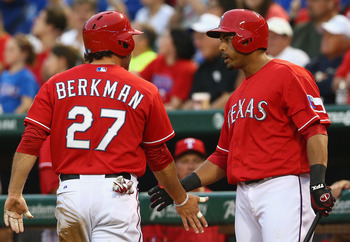 ARLINGTON, TX - APRIL 08:  Lance Berkman #27 of the Texas Rangers celebrates a run with Nelson Cruz #17 of the Texas Rangers at Rangers Ballpark in Arlington on April 8, 2013 in Arlington, Texas.  (Photo by Ronald Martinez/Getty Images)