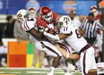 Aggie DT Alonzo Williams makes a tackle in the Cotton Bowl