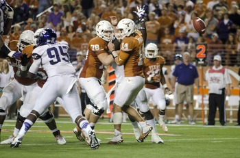 Nov 22, 2012; Austin, TX, USA; Texas Longhorns quarterback David Ash (14) loses the ball against the TCU Horned Frogs during the second quarter at Darrell K Royal-Texas Memorial Stadium. Mandatory Credit: Brendan Maloney-USA TODAY Sports