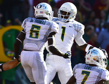 De'Anthony Thomas and Josh Huff celebrate a score against USC