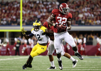C.J. Mosley picks off a pass against Michigan in the Tide's first game of the season.