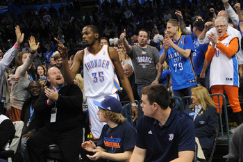 Dec 27, 2012; Oklahoma City, OK, USA;  Oklahoma City Thunder forward Kevin Durant (35) is congratulated by fans after a play against the Dallas Mavericks during overtime at the Chesapeake Energy Arena.  Mandatory Credit: Mark D. Smith-USA TODAY Sports