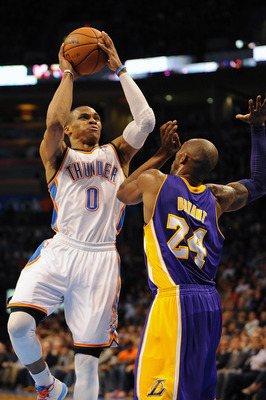 Mar 5, 2013; Oklahoma City, OK, USA; Oklahoma City Thunder guard Russell Westbrook (0) attempts a shot against Los Angeles Lakers guard Kobe Bryant (24) during the second half at Chesapeake Energy Arena. Mandatory Credit: Mark D. Smith-USA TODAY Sports