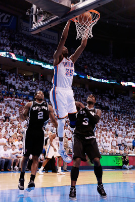 OKLAHOMA CITY, OK - JUNE 06:  Serge Ibaka #9 of the Oklahoma City Thunder dunks the ball against Kawhi Leonard #2 and Stephen Jackson #3 of the San Antonio Spurs in Game Six of the Western Conference Finals of the 2012 NBA Playoffs at Chesapeake Energy Ar