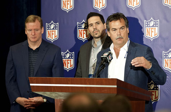 March 20, 2013; Phoenix, AZ, USA;  St. Louis Rams head coach Jeff Fisher (right) speaks as NFL vice president of officiating Dean Blandino (middle) and NFL commissioner Roger Goodell (left) look on during a press conference at the annual NFL meetings at t