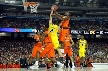 Rakeem Christmas battling Mitch McGary