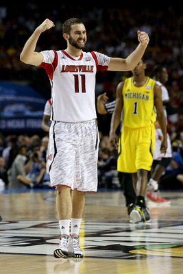 ATLANTA, GA - APRIL 08:  Luke Hancock #11 of the Louisville Cardinals celebrates their 82-76 win against the Michigan Wolverines during the 2013 NCAA Men's Final Four Championship at the Georgia Dome on April 8, 2013 in Atlanta, Georgia.  (Photo by Street