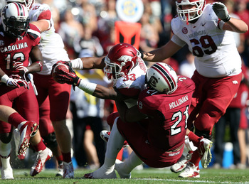COLUMBIA, SC - NOVEMBER 10:  DeVonte Holloman #21 of the South Carolina Gamecocks tackles Dennis Johnson #33 of the Arkansas Razorbacks during their game at Williams-Brice Stadium on November 10, 2012 in Columbia, South Carolina.  (Photo by Streeter Lecka
