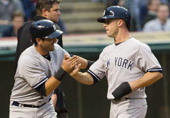 Brett Gardner greets Francisco Cervelli during an April 9 game against the Cleveland Indians