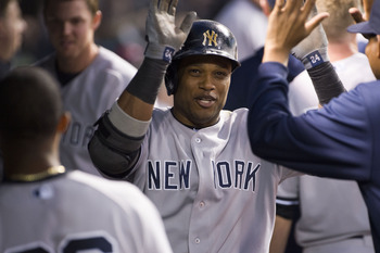 Robinson Cano receives praise in the clubhouse following his home run against the Cleveland Indians on April 9