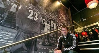 Carragher on the steps of his flagship restaurant, Cafe Sports
