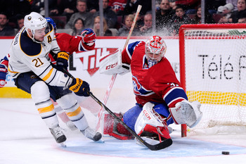 Buffalo Sabre Drew Stafford looks to beat Montreal Canadien Carey Price.