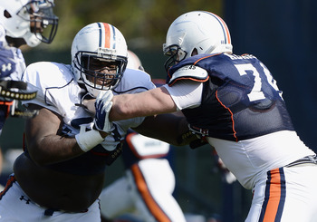 Ben Bradly and Will Adams in spring practice. Photo credit: Todd Van Emst / Auburn media relations