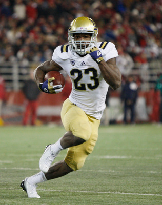 PULLMAN, WA - NOVEMBER 10:  Johnathan Franklin #23 of the UCLA Bruins carries the ball during the game against the Washington State Cougars at Martin Stadium on November 10, 2012 in Pullman, Washington.  (Photo by William Mancebo/Getty Images)