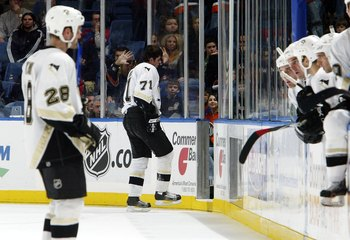 Evgeni Malkin heads to the dressing room after suffering injury