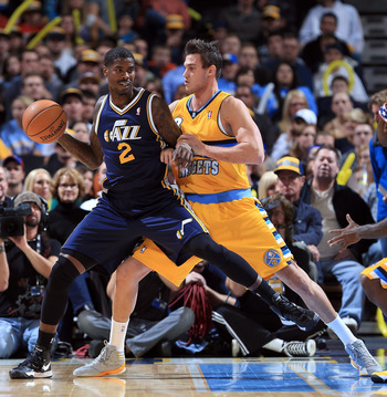 DENVER, CO - NOVEMBER 09:  Marvin Williams #2 of the Utah Jazz controls the ball against Danilo Gallinari #8 of the Denver Nuggets at the Pepsi Center on November 9, 2012 in Denver, Colorado. The Nuggets defeated the Jazz 104-84. NOTE TO USER: User expres