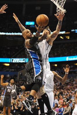 ORLANDO, FL - MARCH 25:  Jameer Nelson #14 of the Orlando Magic is defended by Chris Anderson #11 of the Miami Heat at Amway Center on March 25, 2013 in Orlando, Florida. NOTE TO USER: User expressly acknowledges and agrees that, by downloading and or usi