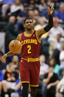 April 9, 2013; Indianapolis, IN, USA; Cleveland Cavaliers guard Kyrie Irving (2) brings the ball up court against the Indiana Pacers at Bankers Life Fieldhouse. Mandatory Credit: Brian Spurlock-USA TODAY Sports