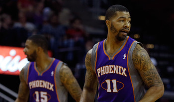 HOUSTON, TX - APRIL 09:  Brothers Markieff Morris #11 (R) and Marcus Morris #15 of the Phoenix Suns are seen on the court during the game against the Houston Rockets at the Toyota Center on April 9, 2013 in Houston, Texas. NOTE TO USER: User expressly ack