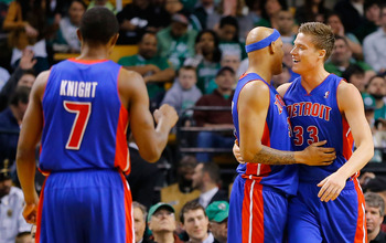 BOSTON, MA - APRIL 3:  Jonas Jerebko #33 of the Detroit Pistons is congratulated by teammate Charlie Villanueva #31 of the Detroit Pistons during the game against the Boston Celtics on April 3, 2013 at TD Garden in Boston, Massachusetts. NOTE TO USER: Use