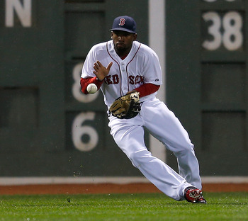 BOSTON, MA - APRIL 10: Jackie Bradley Jr. #44 of the Boston Red Sox misplays a ball for an error that allowed a run to score in the fourth inning against the Baltimore Orioles at Fenway Park on April 10, 2013 in Boston, Massachusetts.  (Photo by Jim Rogas