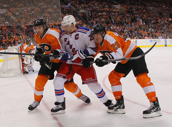 Rangers captain Ryan Callahan battles for a puck in Philadelphia.