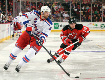 Rick Nash carries the puck in a game versus the New Jersey Devils.