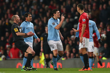 Gareth Barry lectures Rio Ferdinand in his typical gritty style.