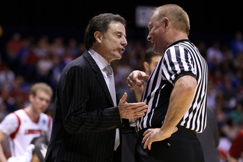Rick Pitino argues with an NCAA referee