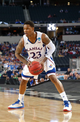 Mar 29, 2013; Arlington, TX, USA; Kansas Jayhawks guard Ben McLemore (23) looks to shoot during the game against the Michigan Wolverines during the semifinals of the South regional of the 2013 NCAA Tournament at Cowboys Stadium. Mandatory Credit: Kevin Ja