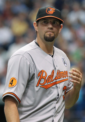 April 2, 2012; St. Petersburg, FL, USA; Baltimore Orioles starting pitcher Jason Hammel (39) against the Tampa Bay Rays during opening day at Tropicana Field. Mandatory Credit: Kim Klement-USA TODAY Sports